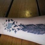tatuagem de pena